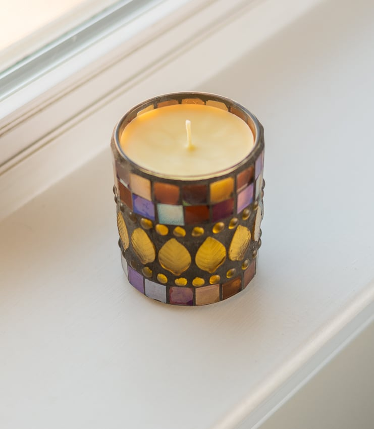 small beeswax candle with wick
