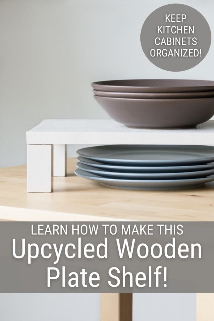 plates under a raised shelf plate and bowls on it with text Learn How to Make This Upcycled Wooden Plate Shelf