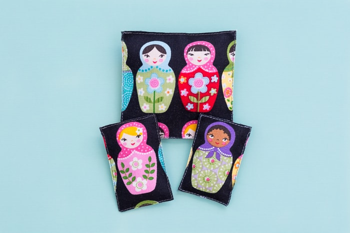 Learn how to make matryoshka doll catnip toys using cute little fabric scraps, some catnip, and limited sewing skills (plus no-sew options!).