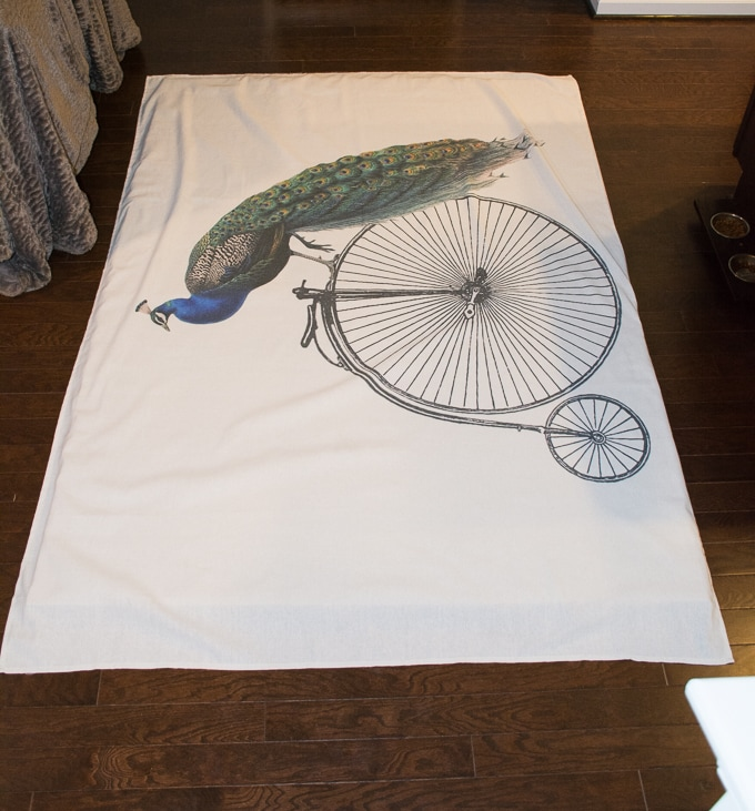 peacock on a bike tapestry