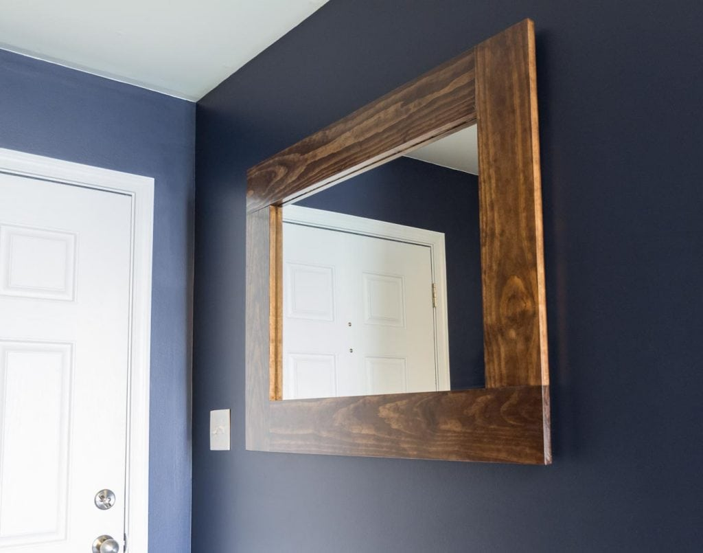 small entryway painted with Sherwin-Williams paint in Anchors Aweigh and Repose Gray