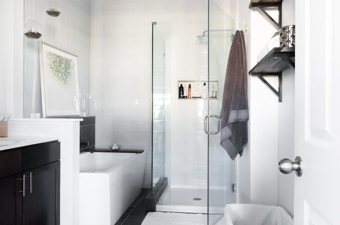Master Bathroom Reveal Photos // Dark gray large format tile, white glass subway tile, modern freestanding tub, small frameless shower, small bathroom ideas