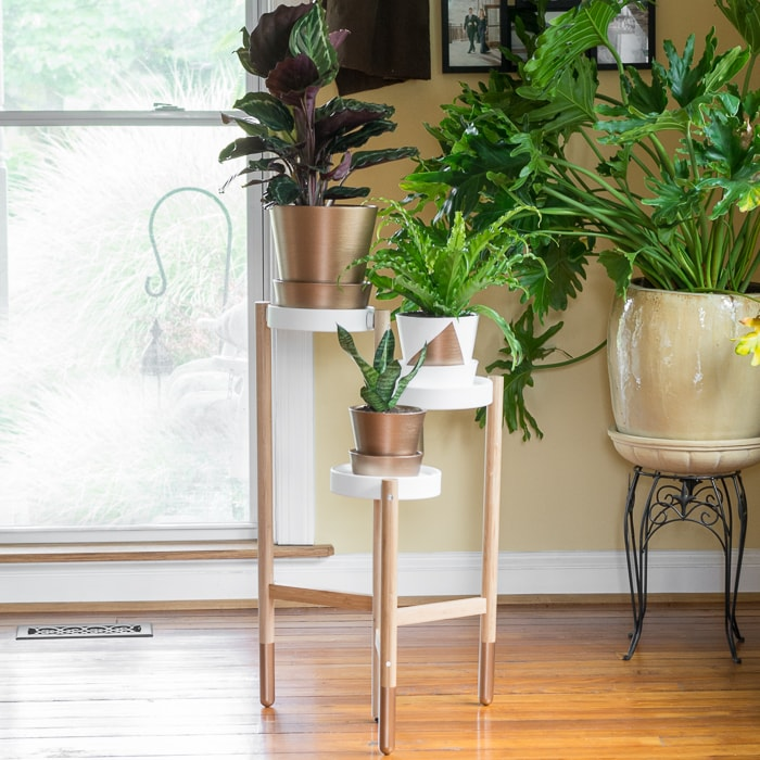 Greenery & Painted Gold Accents: See how I made over an Ikea Satsumas plant stand and painted some pots to match!