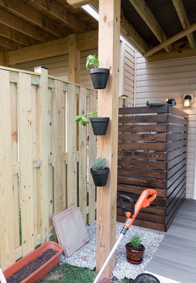 hanging painted pots on a deck post