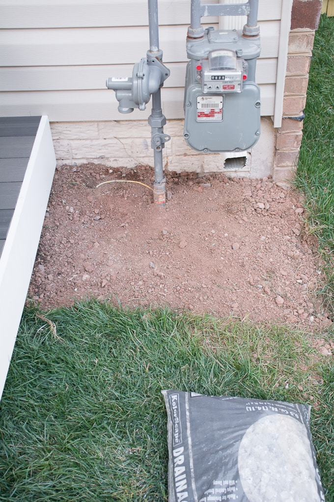 how to lay rock landscaping around a platform deck