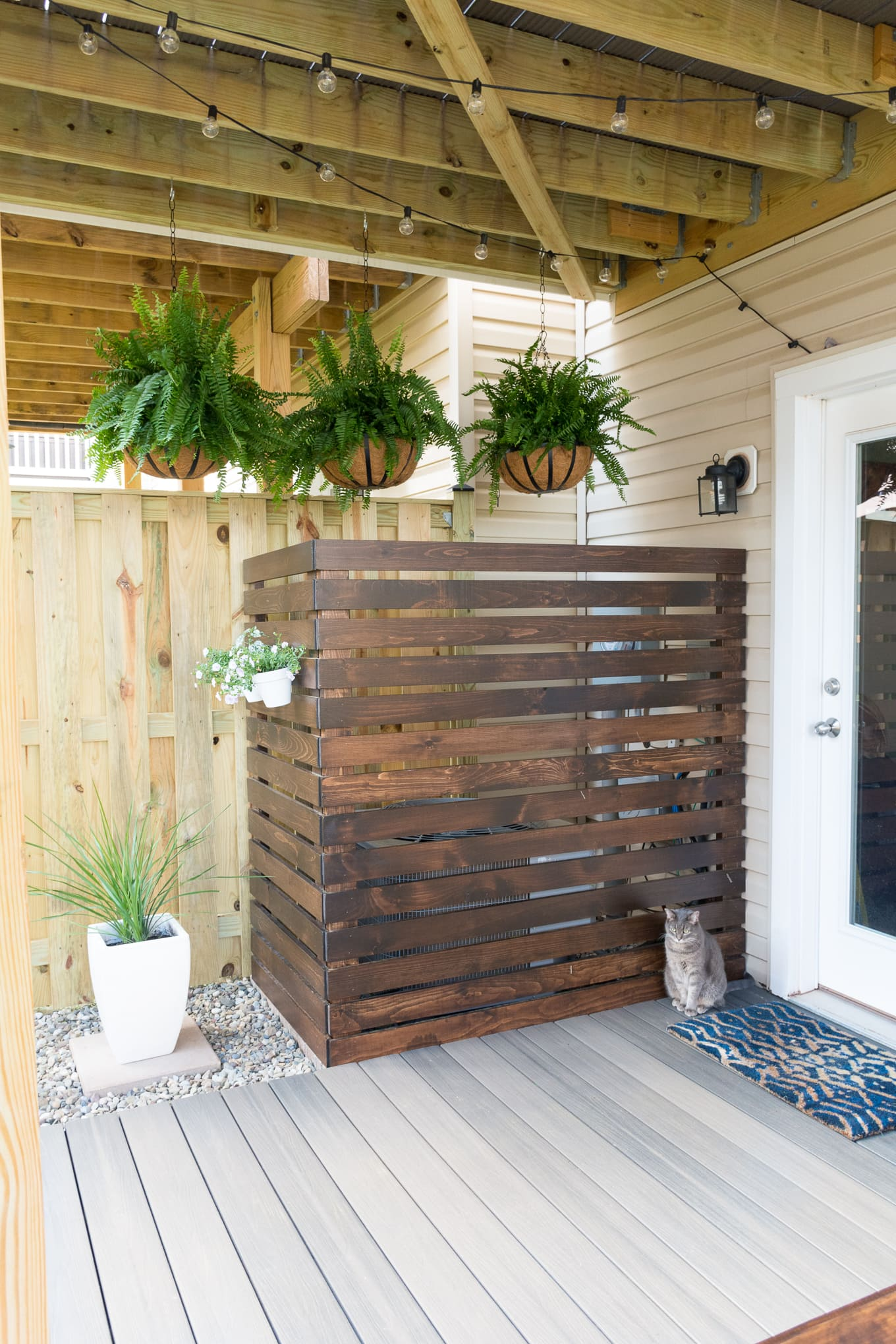 Modern design ideas for a small backyard // Hanging ferns // DIY AC screen // DIY HVAC unit screen // My Tiny Backyard // by Brittany Goldwyn
