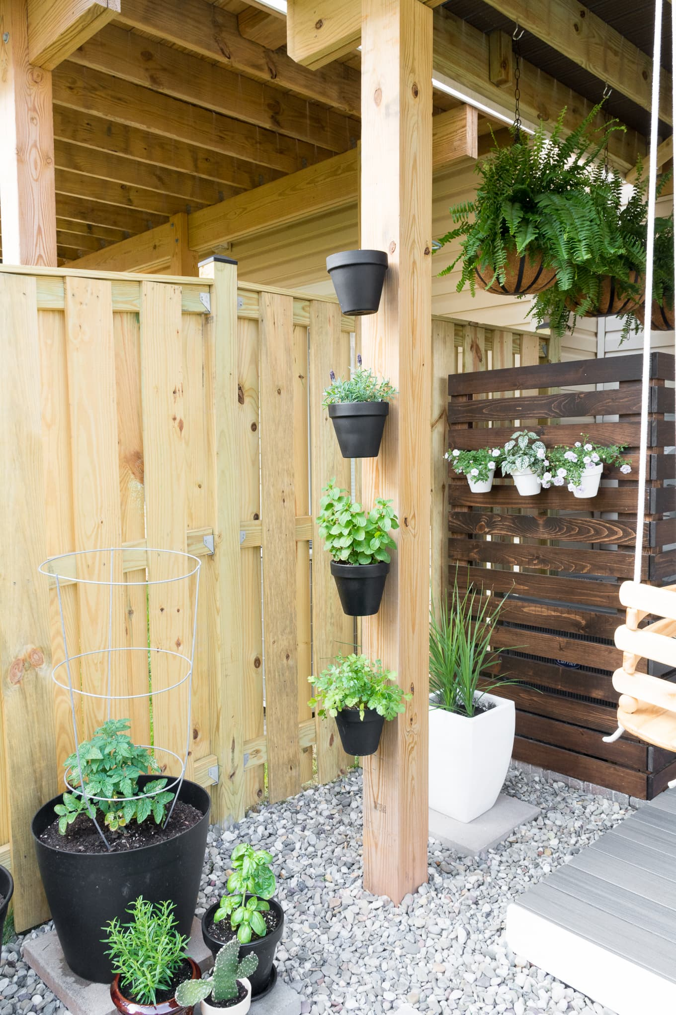 Modern design ideas for a small backyard // Hanging ferns // DIY AC screen // DIY HVAC unit screen // hanging herbs // pot klips // My Tiny Backyard // by Brittany Goldwyn