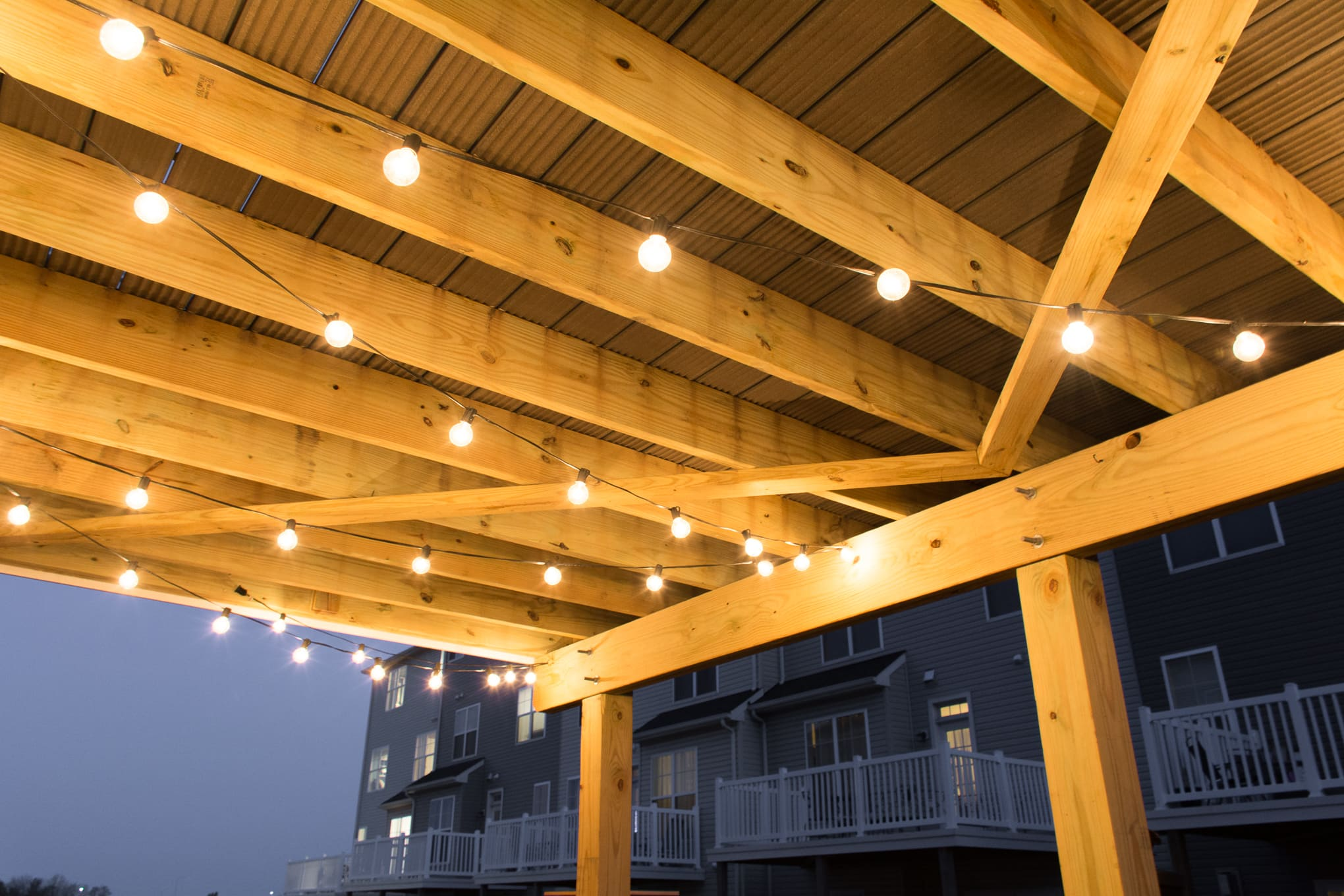 Hanging globe string lights under a deck