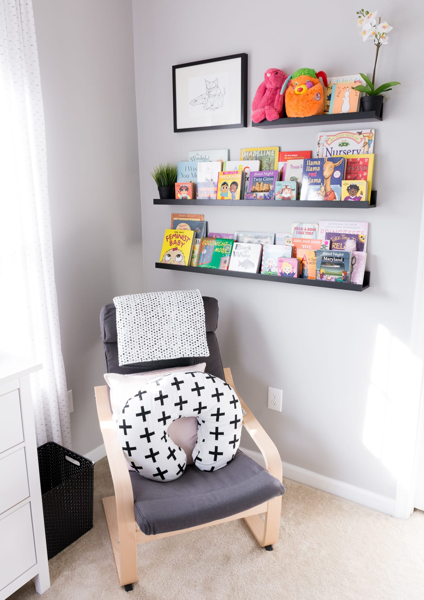 A Modern and Neutral Nursery // Behr Silver City, Behr Dark Granite // Ikea Mosslanda as a book shelf // // Ikea Poang in nursery