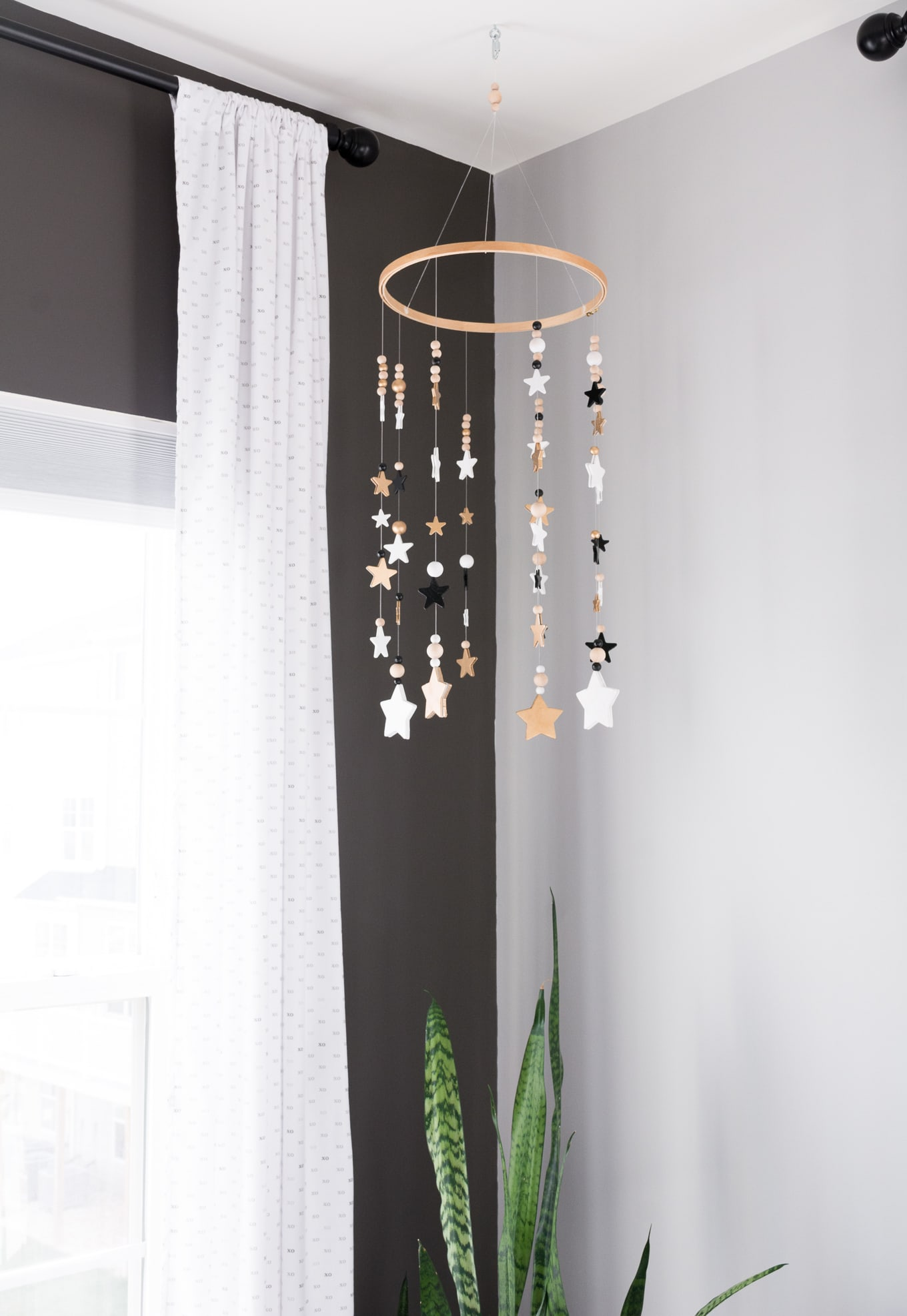 A Modern and Neutral Nursery // Behr Silver City, Behr Dark Granite // DIY nursery mobile