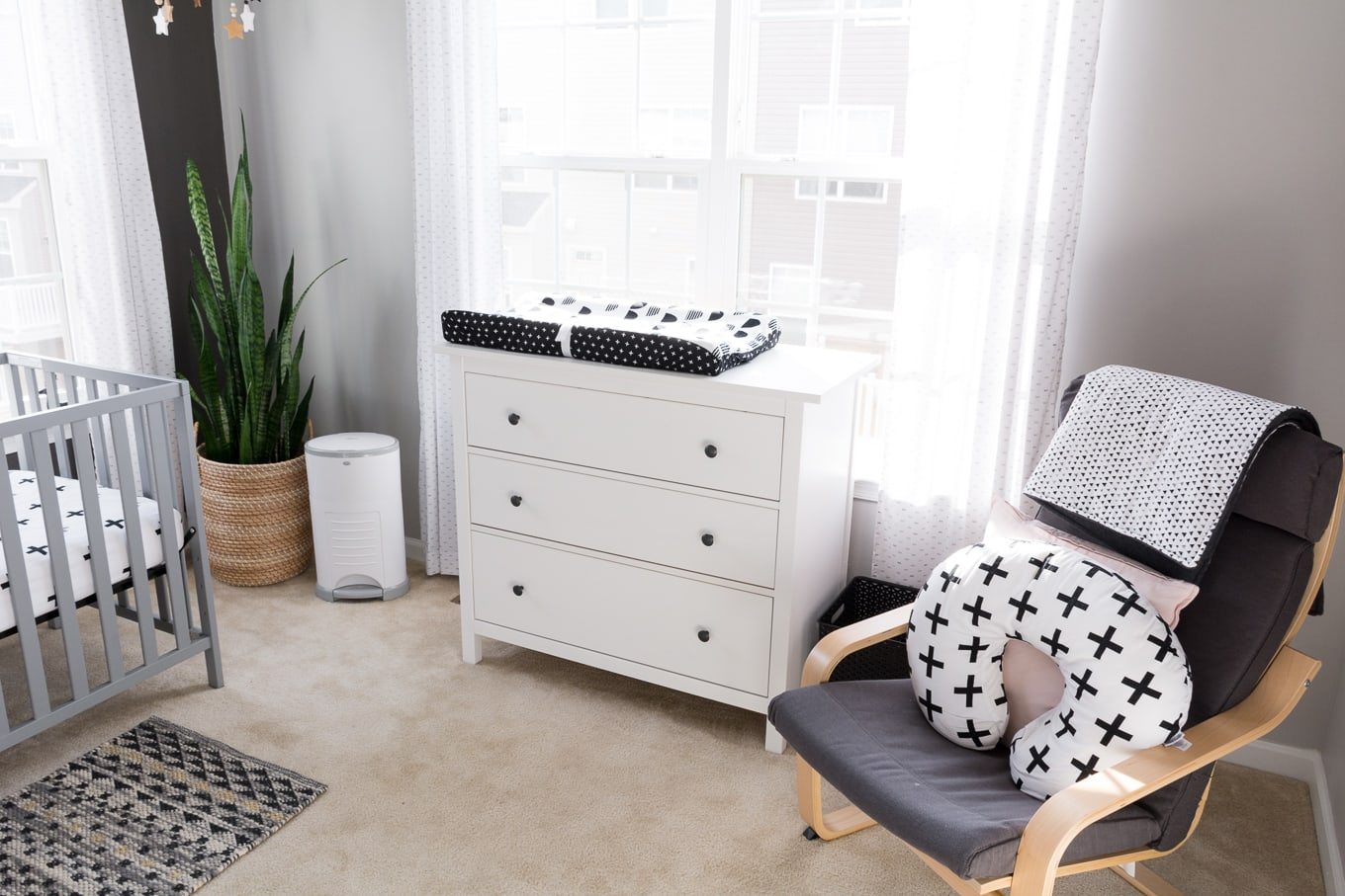 A Modern and Neutral Nursery // Behr Silver City, Behr Dark Granite // Ikea Poang in nursery // Ikea Hemnes in nursery
