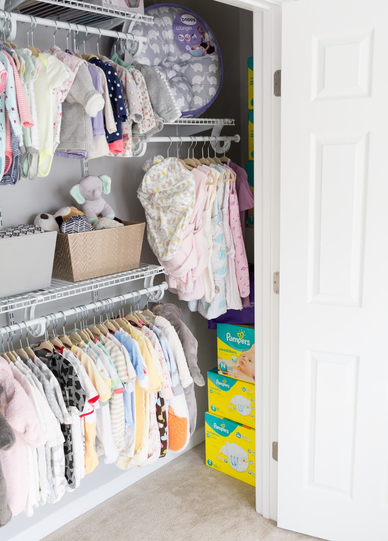 A Modern and Neutral Nursery // Behr Silver City, Behr Dark Granite // Nursery closet organization