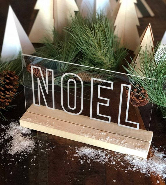 engraved acrylic NOEL sign