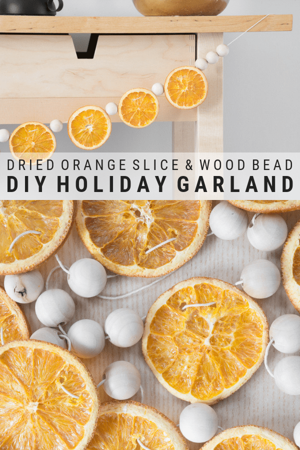 DIY dried orange slice and wood bead garland, the perfect holiday garland #holidaydecor #naturaldecor #holidaydiy #diy #diygarland #orangeslicegarland #driedorangeslices #christmasgarland #christmascrafts #holidaycrafts