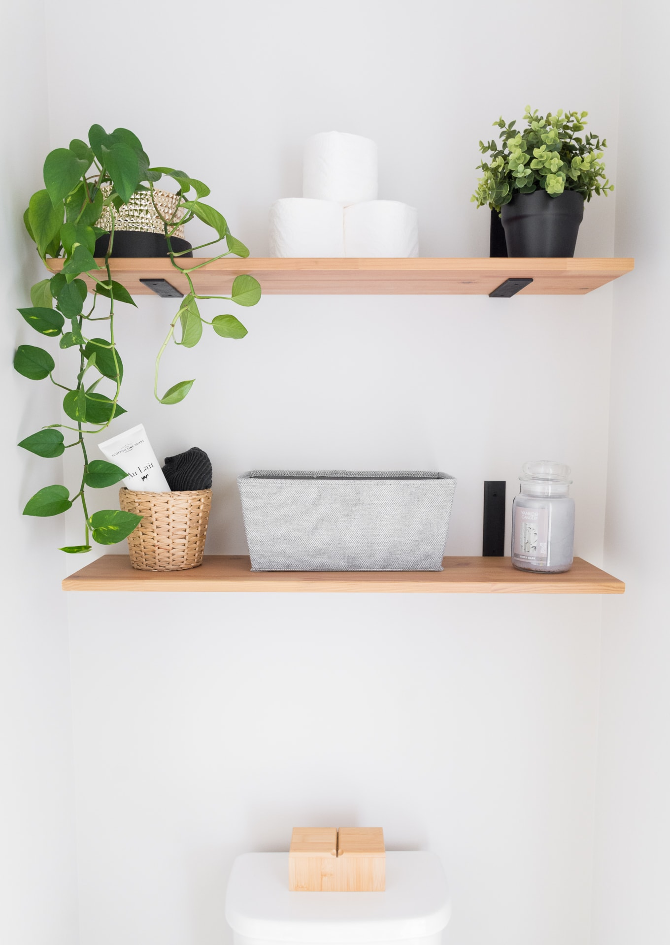 Clean and simple powder room. Our modern minimal townhouse for a family of three (and two kitties!). Looking for townhouse decorating ideas? Check out our home tour. #townhomes #townhouse #townhousedecoratingideas #townhouseideas #modernhomedecor #townhouseinspiration #diy #modernhomedecor #scandanavianinterior #nordicinspired #scandanavianinspired #scandiinspired #houseplants #powderroom #smallbathroom #modernpowderroom