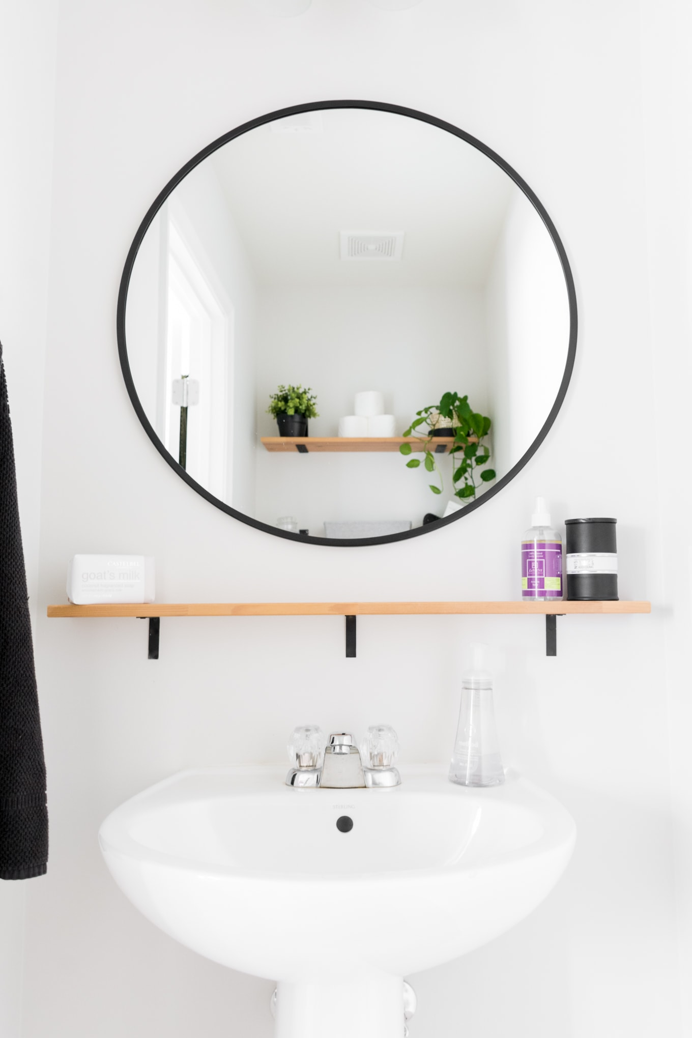 Clean and simple powder room in our Modern Minimal Townhome
