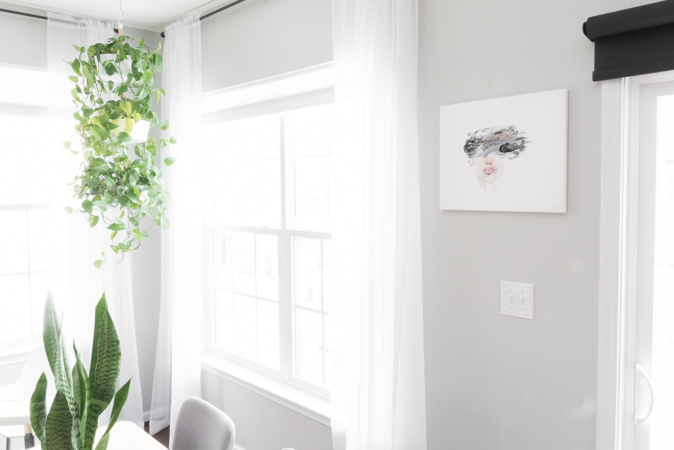 Simple, modern dining room. Our modern minimal townhouse for a family of three (and two kitties!). Looking for townhouse decorating ideas? Check out our home tour. #townhomes #townhouse #townhousedecoratingideas #townhouseideas #modernhomedecorlivingroom #modernhomedecor #kidfriendlyhome #townhouseinspiration #openconcept #townhomelayout #townhouselayout #diy #modernhomedecor #scandanavianinterior #nordicinspired #scandanavianinspired #scandiinspired #houseplants #hangingplants #reposegray