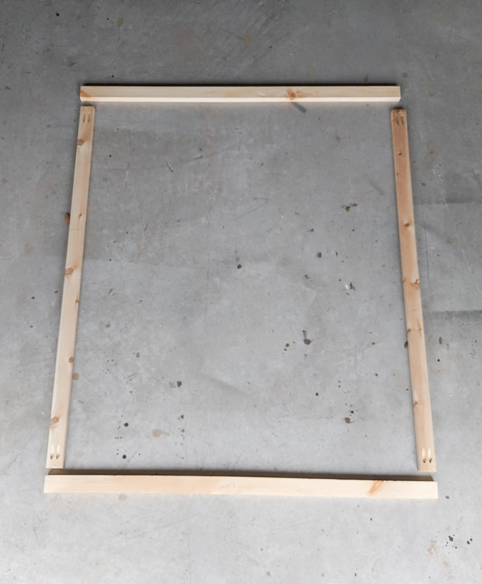 Wood frame for a bathroom mirror