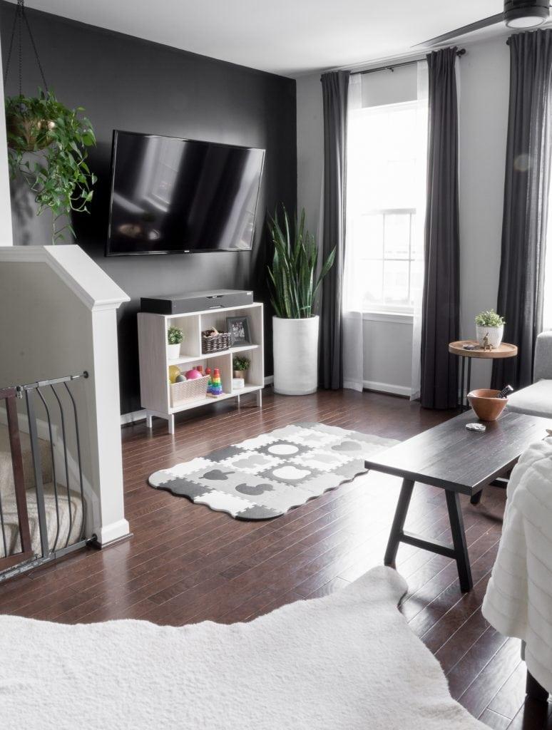 Tricorn black living room wall