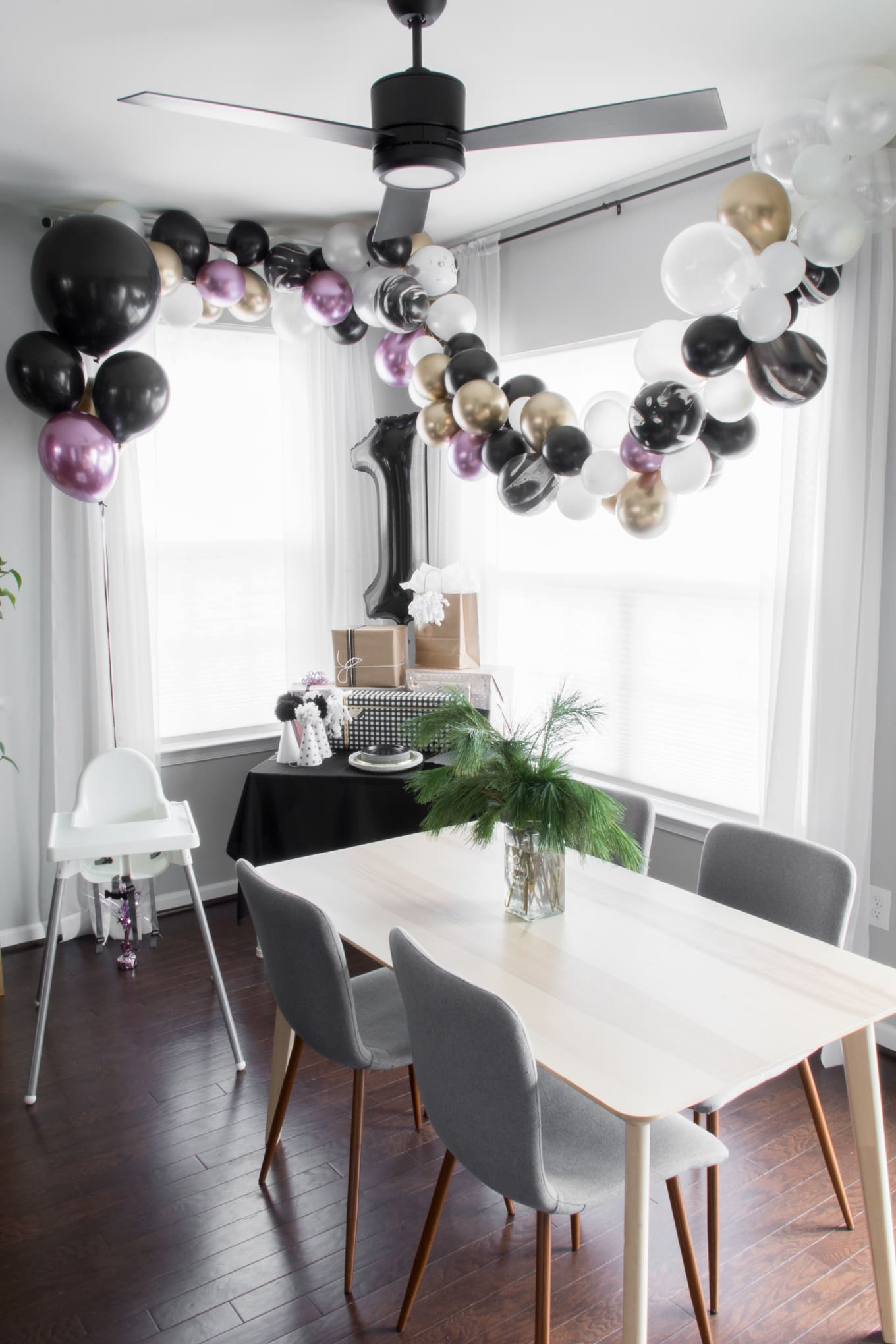 Ramona's modern handmade first birthday party. Looking for modern birthday party decor ideas? #modernfirstbirthday #firstbirthdaydecor #chicfirstbirthday #blackandwhiteballoons #goldballons #firstbirthday #balloongarland #DIYpartyhats #diycaketopper #monochromebirthday