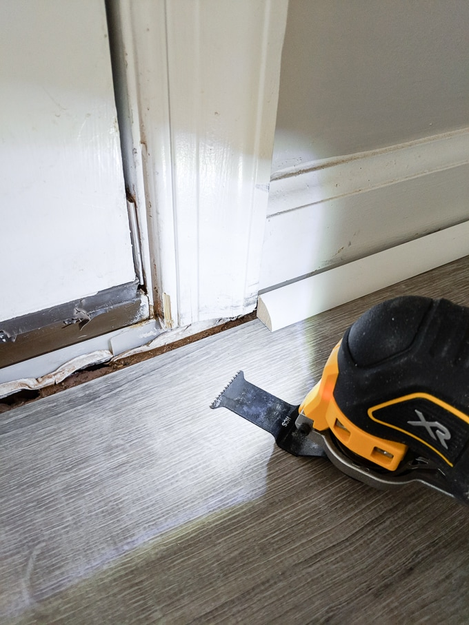 Marking where to cut the door trim to fit our door threshold
