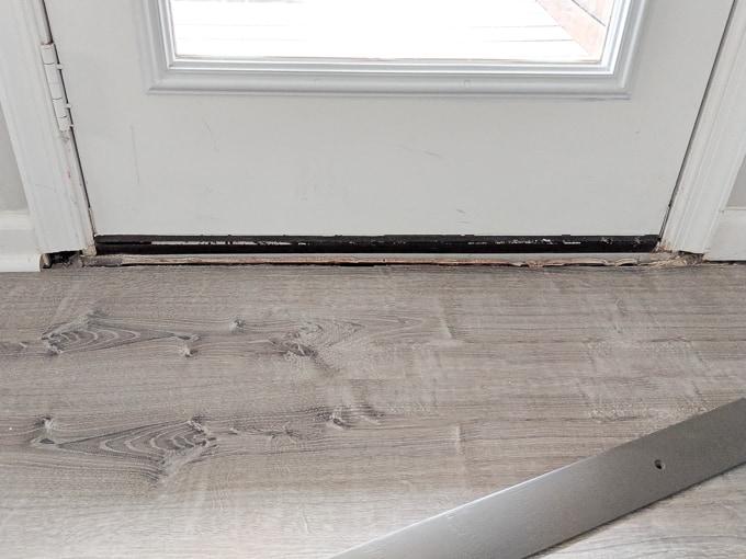 Painted oak door threshold to match our vinyl plank flooring