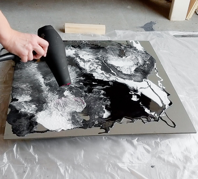 Mix epoxy resin paint on plywood with a high-powered hairdryer