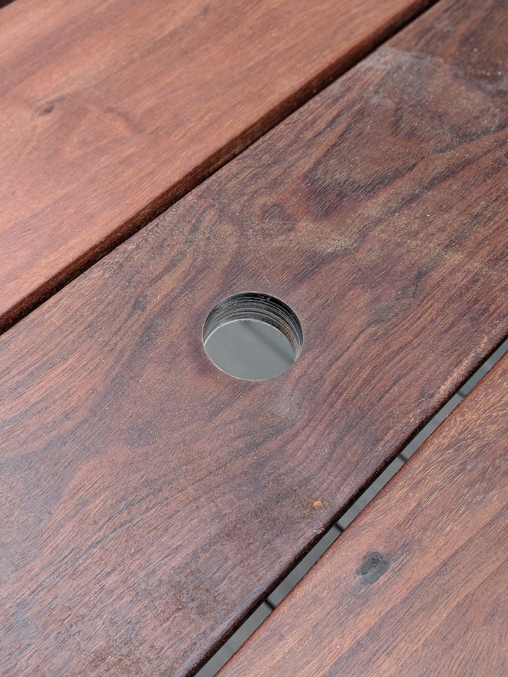 drilling an umbrella hole for a patio table