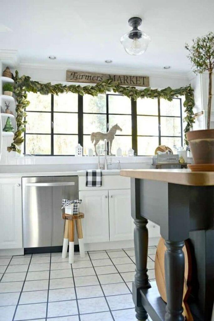 Magnolia garland draped above kitchen window