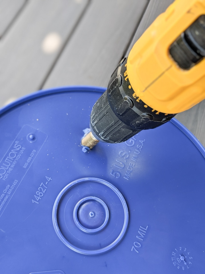 drilling holes in a bucket
