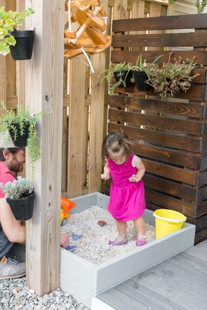 How to make an easy DIY sandbox or gravel pit play area.