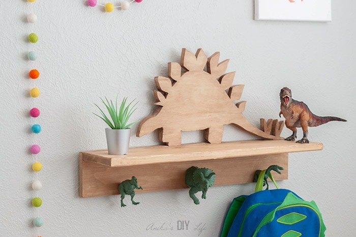 Hand cut dinosaur shelf by Anika Gandhi from Anika's DIY Life