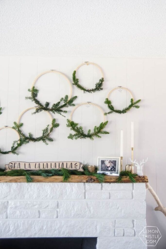 Natural Christmas Decorations: 6 simple holiday wreaths with fresh greenery hanging above a fireplace