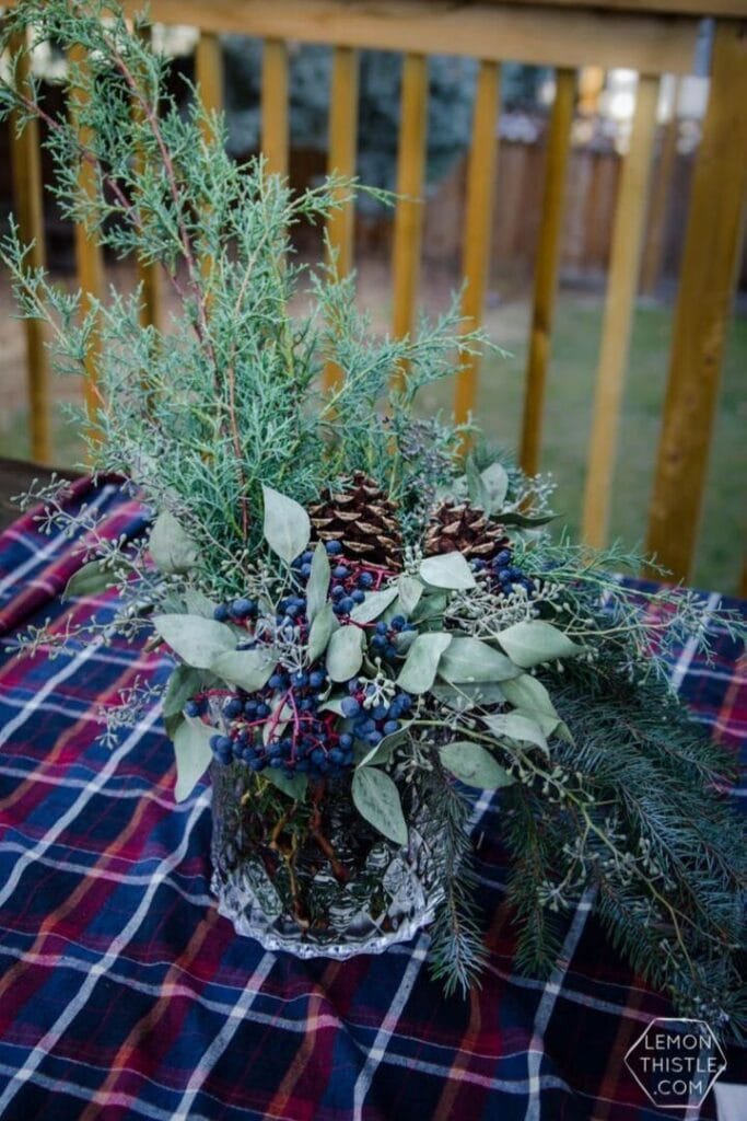 Natural Christmas Decorations: Natural centerpiece sitting on a flannel tablecloth