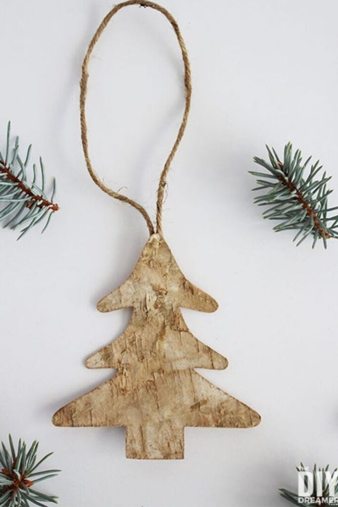 Christmas tree shaped ornament made from birch with jute string for hanging