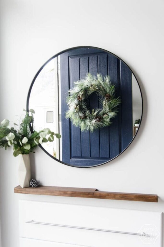 Front entry mirror with reflection of a Christmas Wreath