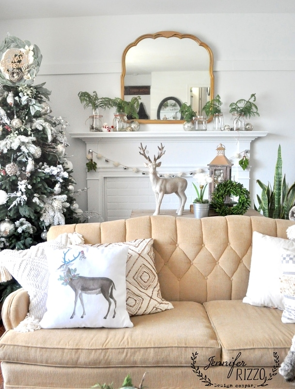 Fresh pine sprigs in mason jars on a white mantle: Natural Christmas Decorations