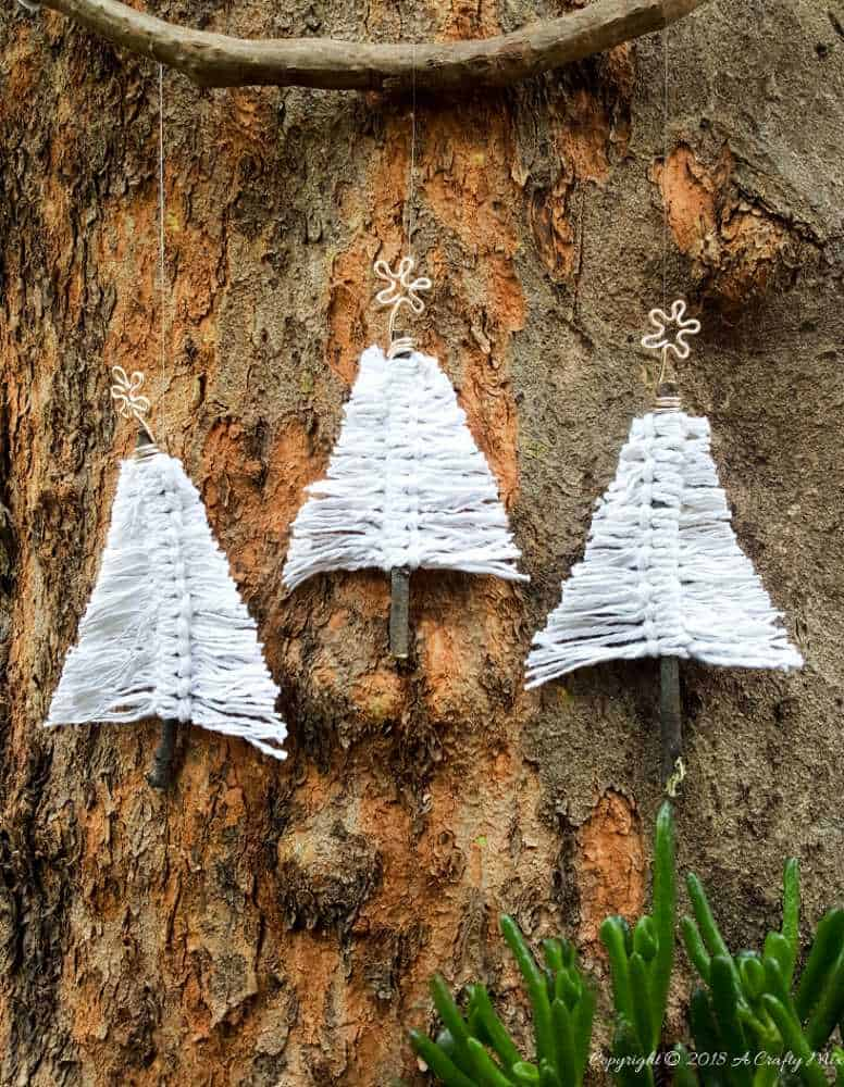 3 white macrame Christmas trees made on twigs with gold wire star topper