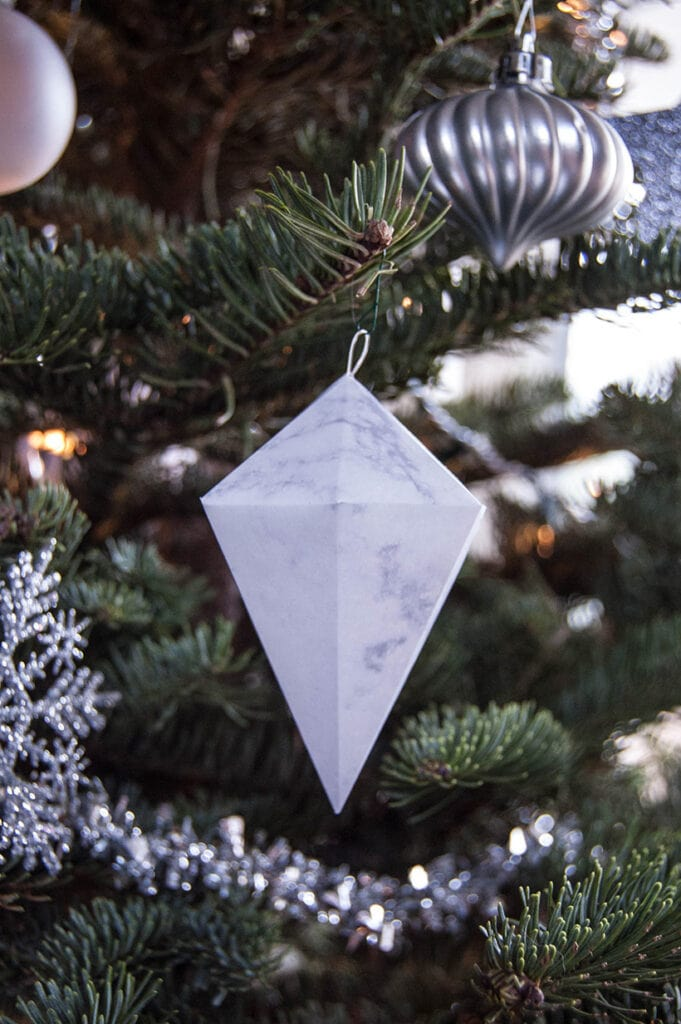 Marble geometric ornament hanging on a Christmas tree