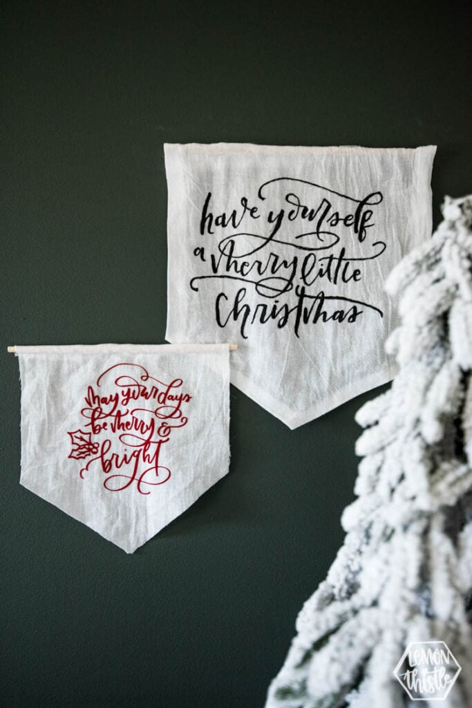 DIY holiday pennants one small on with red lettering one large one with black lettering