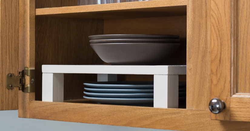 DIY raised plate shelf for a cabinet