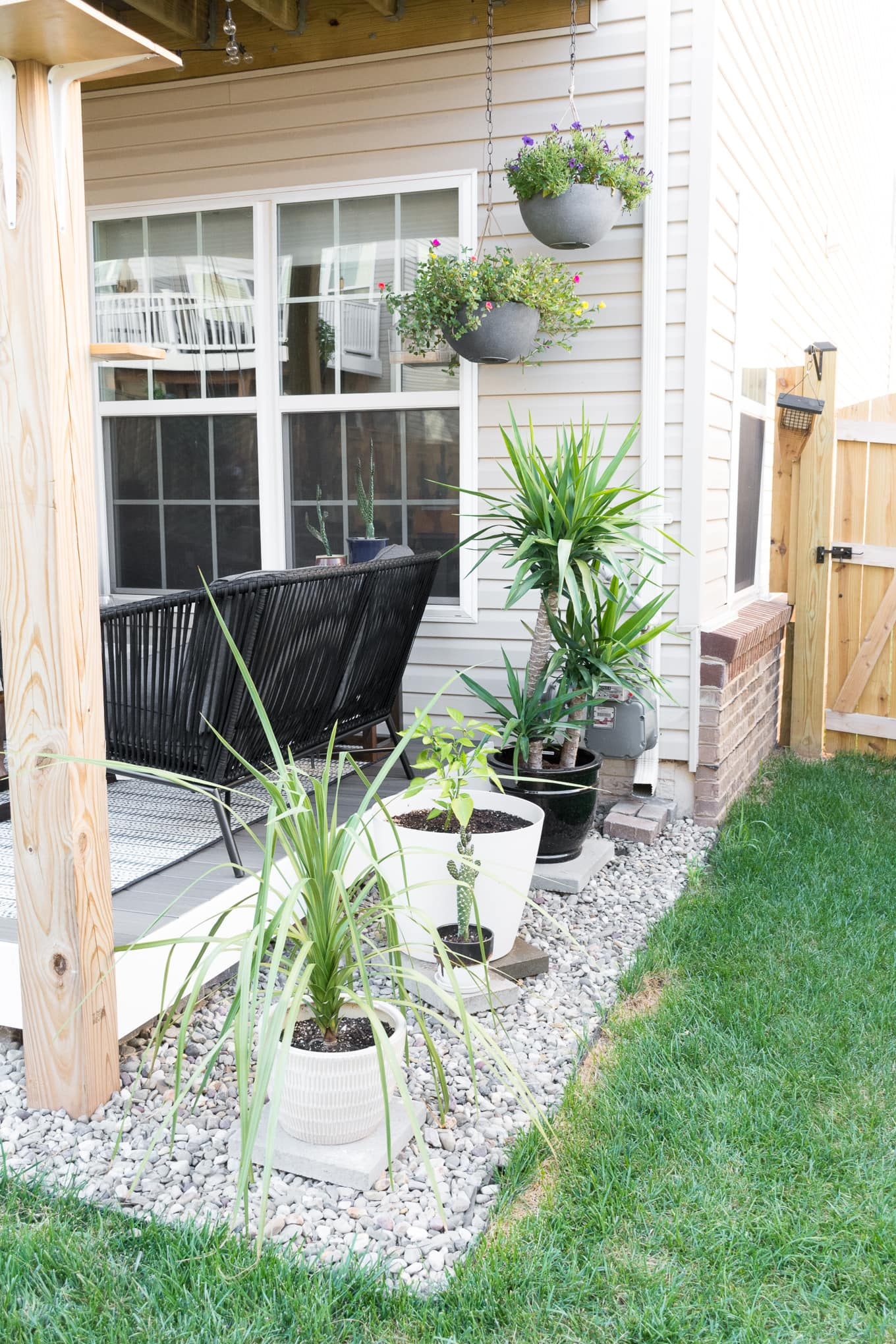 Hanging baskets and potted plants for a small backyard deck