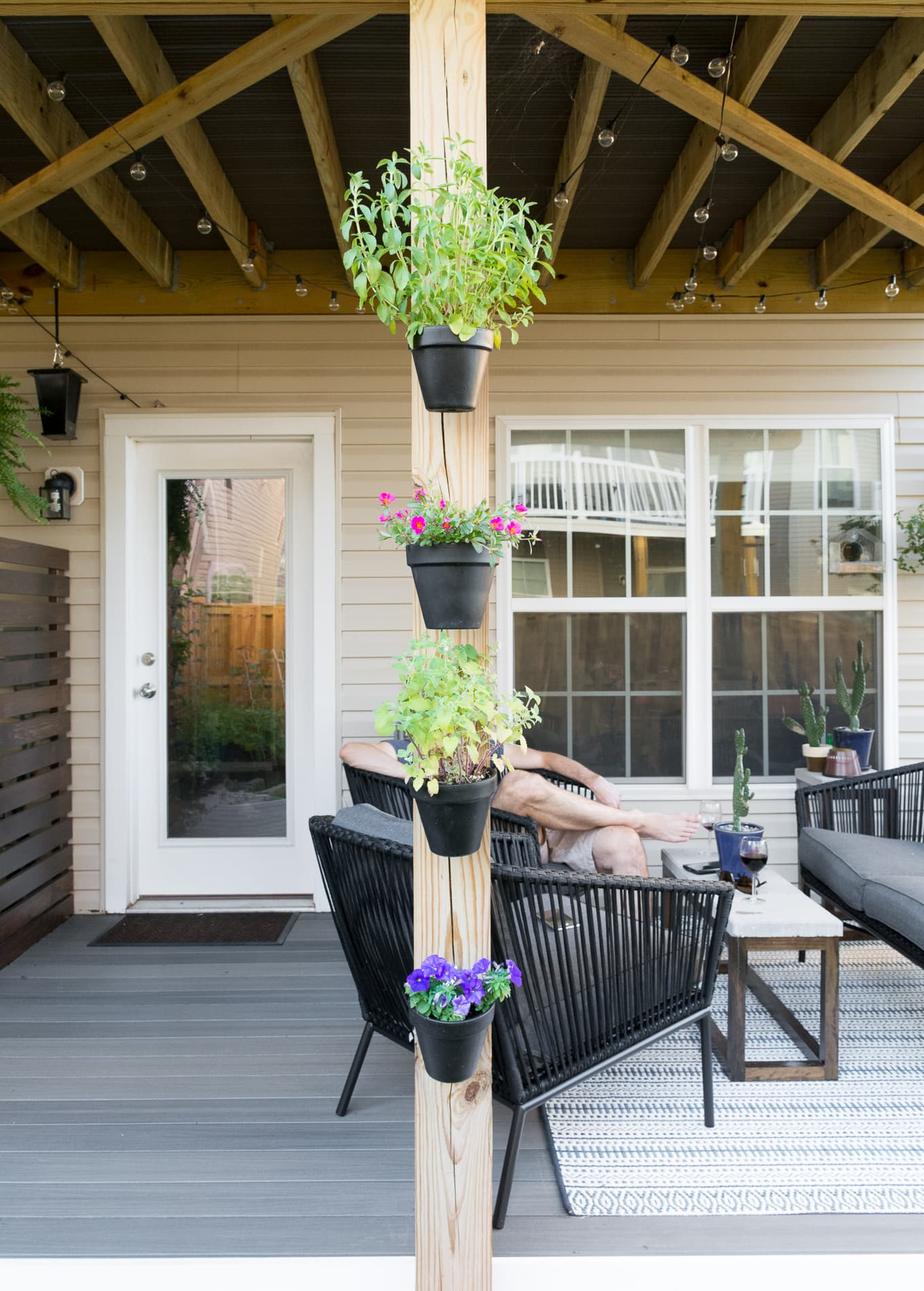 Hanging pots in a beautiful small backyard