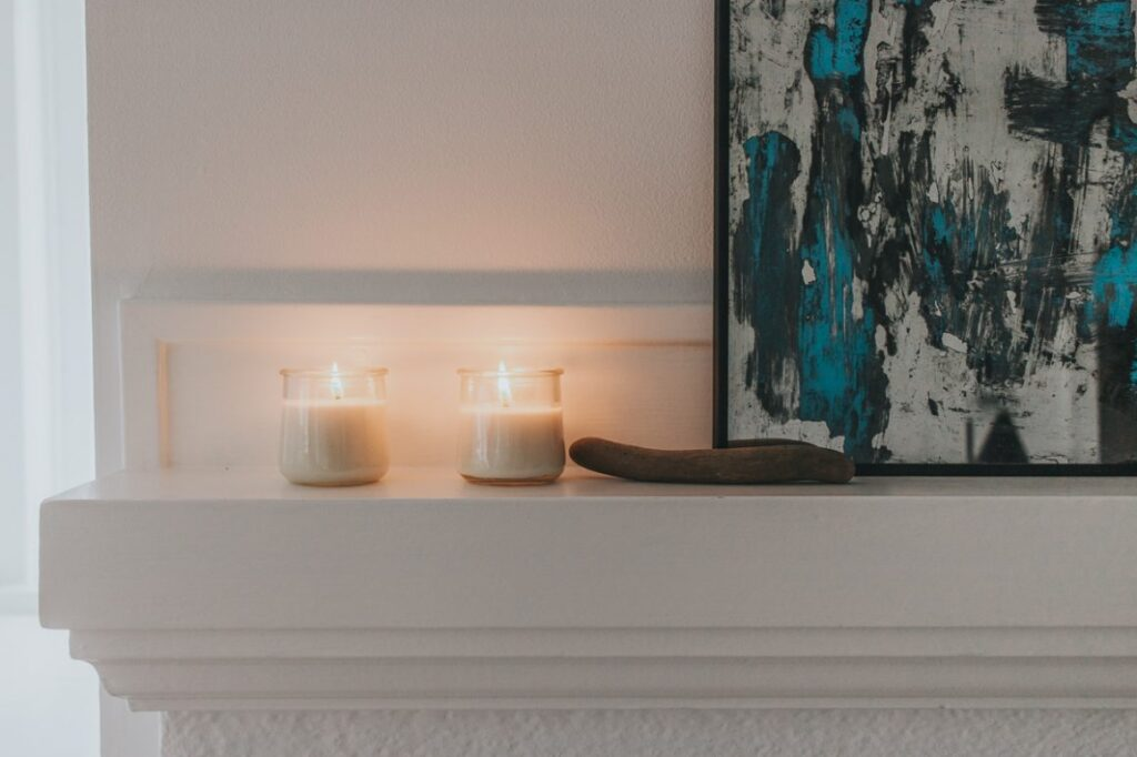 DIY soy candles in jars on a mantle