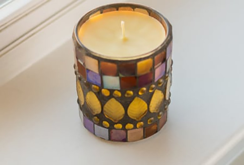 DIY beeswax candle with coconut oil in mosaic candle holder