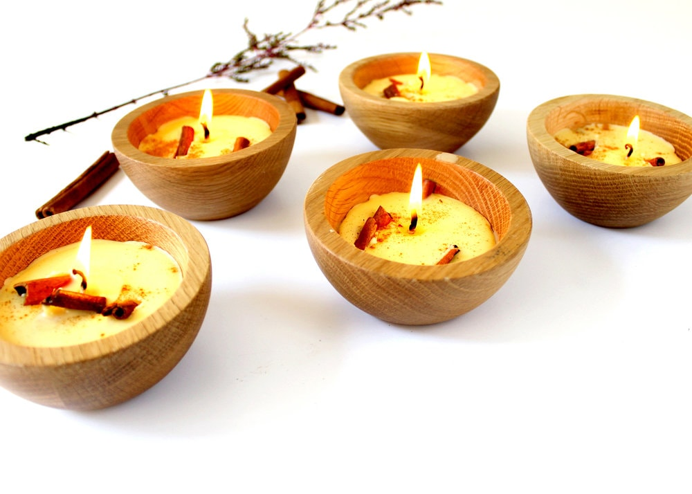 lit candles in wooden bowls
