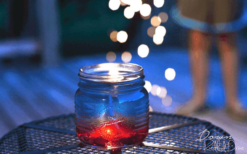 red and blue DIY citronella candle in a mini mason jar