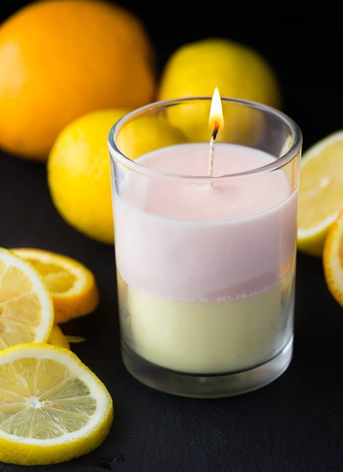 layered citrus essential oil candle in a glass jar