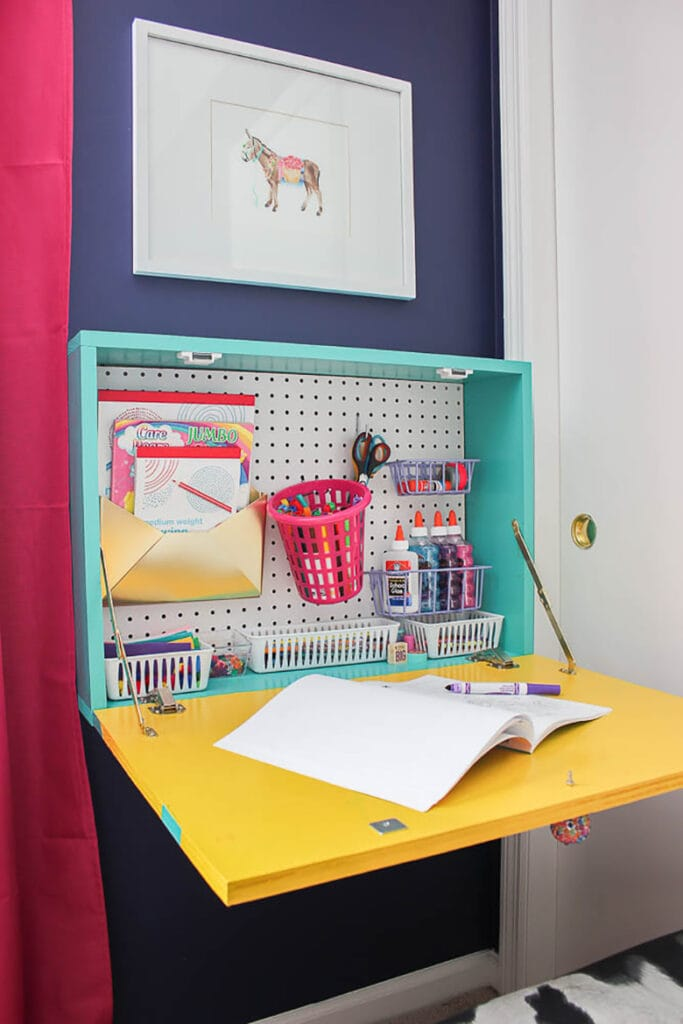Wall mounted kid's drop down desk for kids spaces