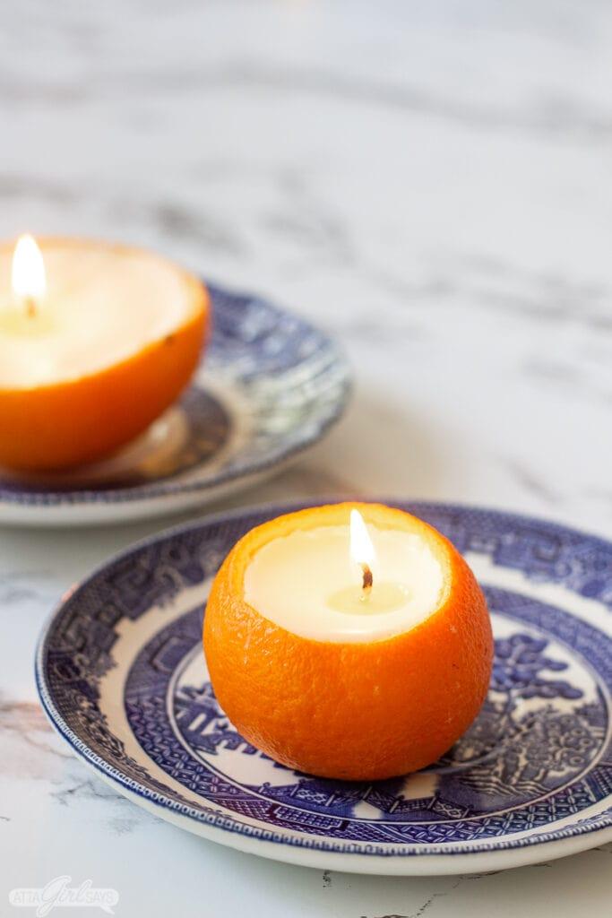 Orange DIY essential oil candles in orange peels